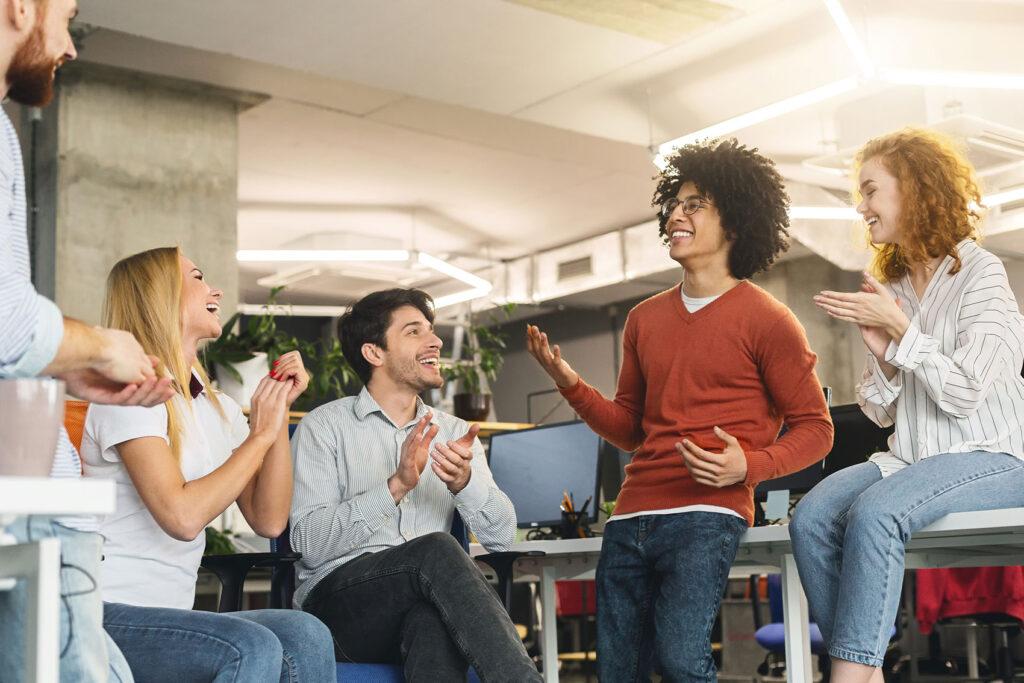 creative-team-enjoying-communication-in-modern-off-UCJ6X4R.jpg