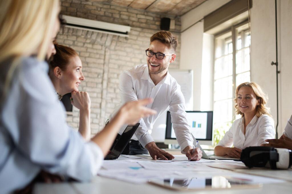 happy-creative-team-in-office-business-startup-des-K9DEN3B.jpg